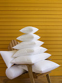 Stack of Pillows on Adirondak Chair