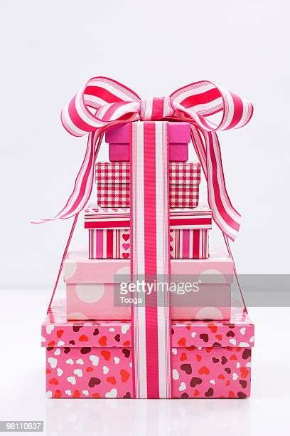 Stack of pink presents with bow