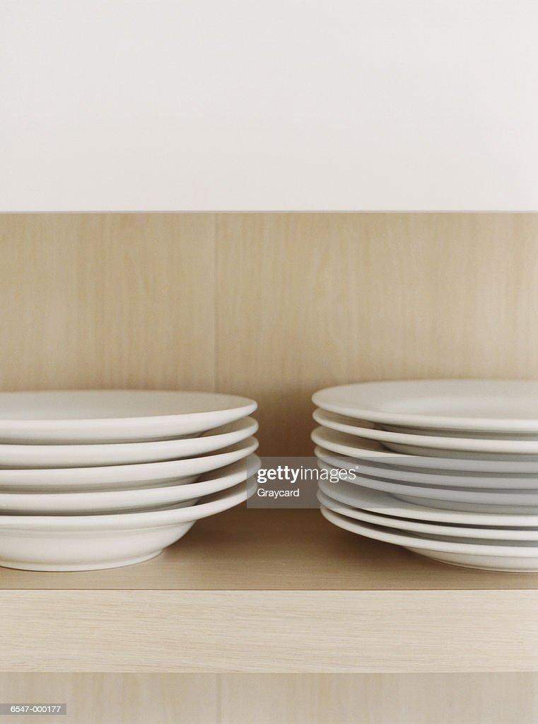 Stack of Plates on Shelf : Stock Photo