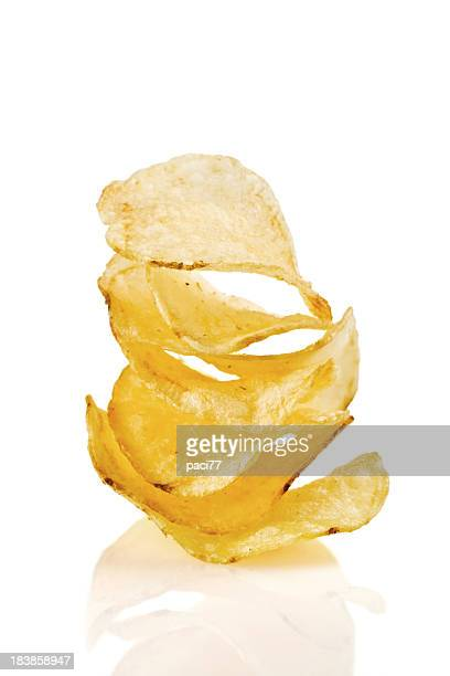 Stack of potato crisps on a white background