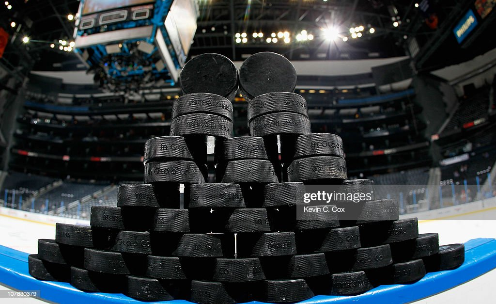 A stack of practice pucks sit on the boards before warmups for the Atlanta Thrashers and the Carolina Hurricanes at Philips Arena on December 16 2010...