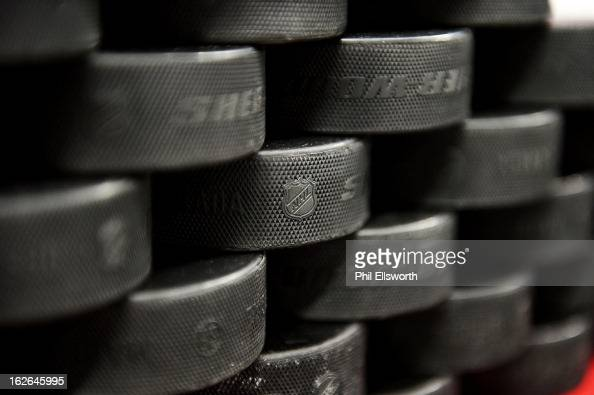 A stack of practice pucks sits ready for the Carolina Hurricanes during an NHL game against the Winnipeg Jets on February 21 2013 at PNC Arena in...