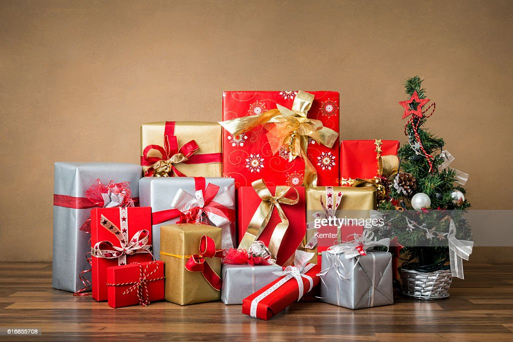 stack of red, silver and golden gifts : Stock Photo