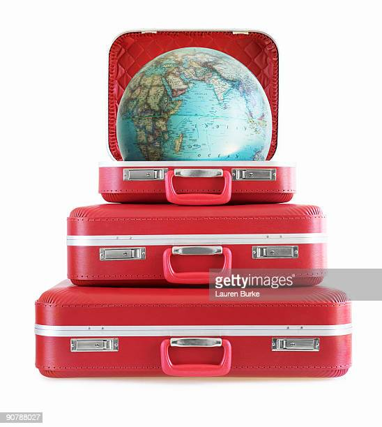 Stack of Red Suitcases with Globe