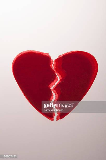 A stack of red tissue paper broken hearts