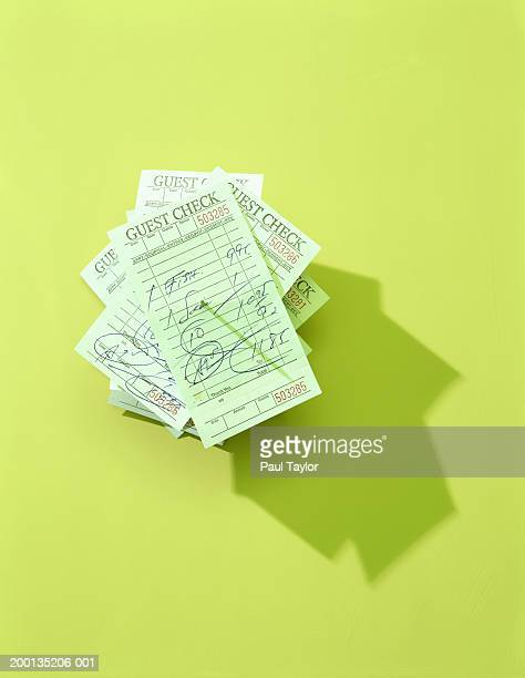 Stack of restaurant bills on paper spindle, elevated view