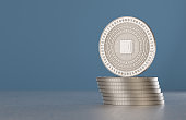 Stack of silver crypto-currency coins with cpu symbol as example for digital currency, online banking or fin-tech