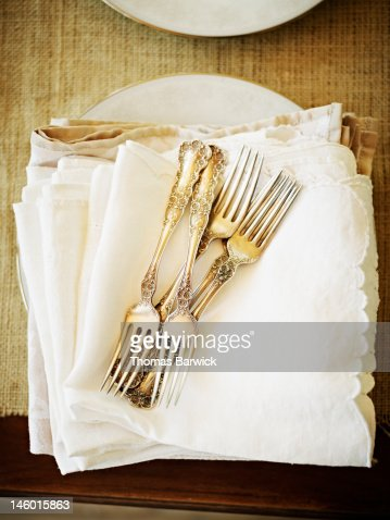 Stack of silver forks and napkins overhead view : Stock Photo