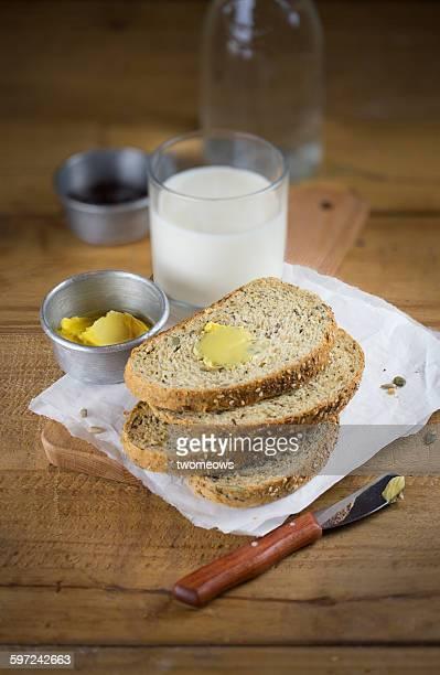 Stack of sliced whole grain bread.