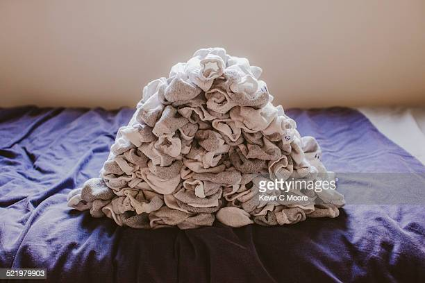 Stack of socks on top of bed
