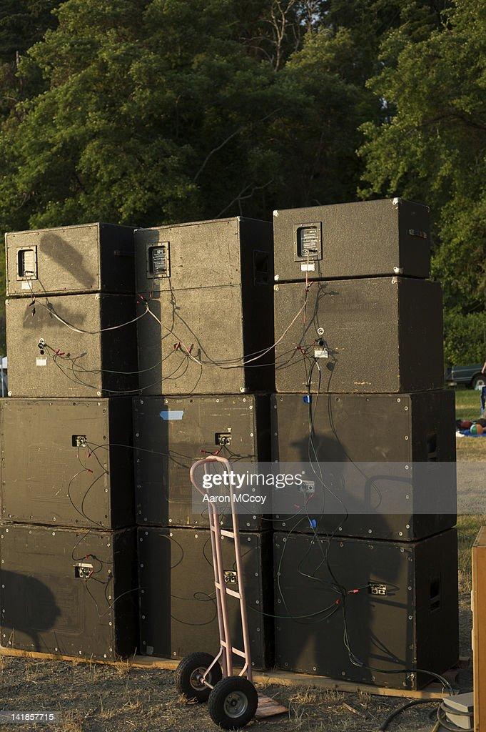 Stack of speakers with shadow and hand truck, Vashon Island, Washington : Stock Photo