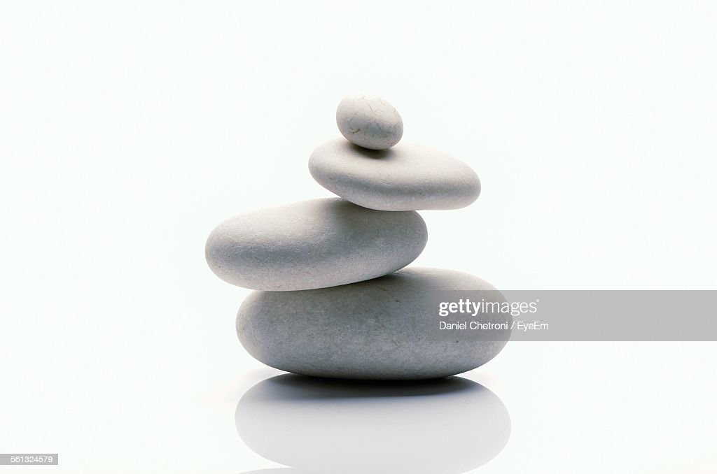 Stack Of Stones Against White Background