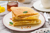 Stack of thin pancakes crepes with caramel toffee topping
