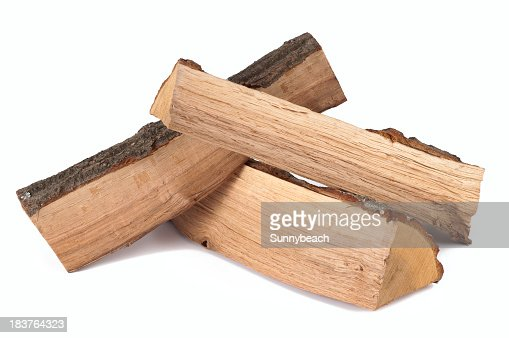 Stack of three cut logs with bark