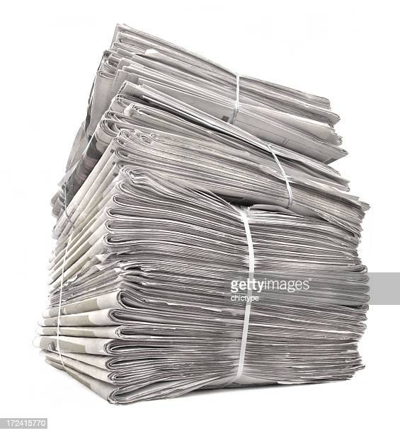 A stack of tied newspapers on white