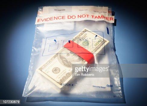 Stack of US$100 bills in evidence bag