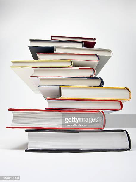 A stack of various hardcover books, diminishing perspective