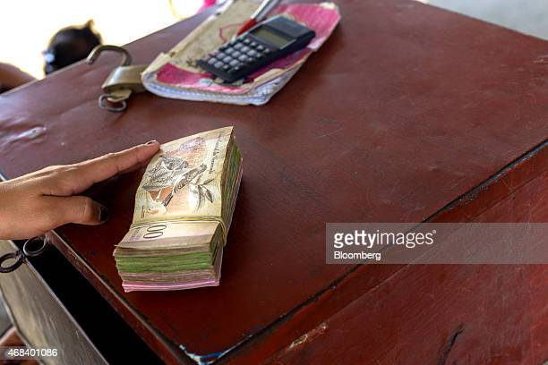 A stack of Venezuelan 100 bolivar notes sits on the table of a black market currency exchanger in Cucuta Colombia on Monday Feb 23 2015 Colombians in...