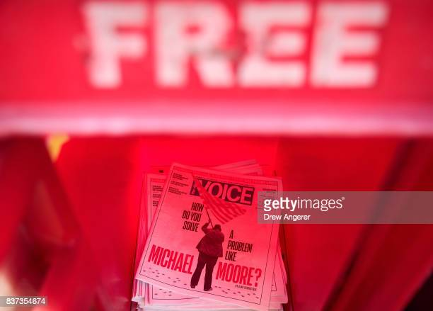 A stack of Village Voice newspapers sit in a newspaper stand in the East Village neighborhood in Manhattan August 22 2017 The Village Voice one of...
