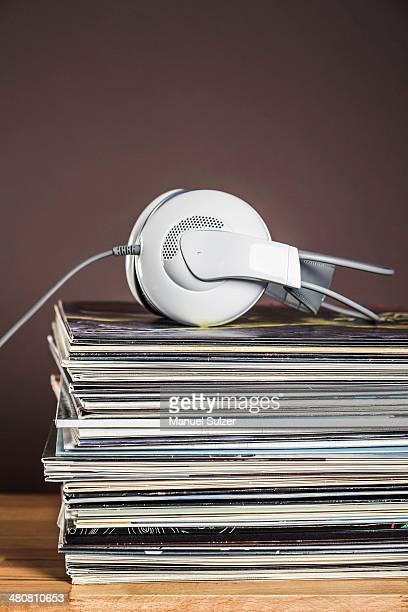 Stack of vinyl records with headphones