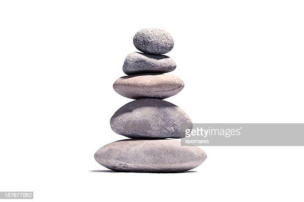 Stack of volcanic pebbles isotaded on white with clipping path