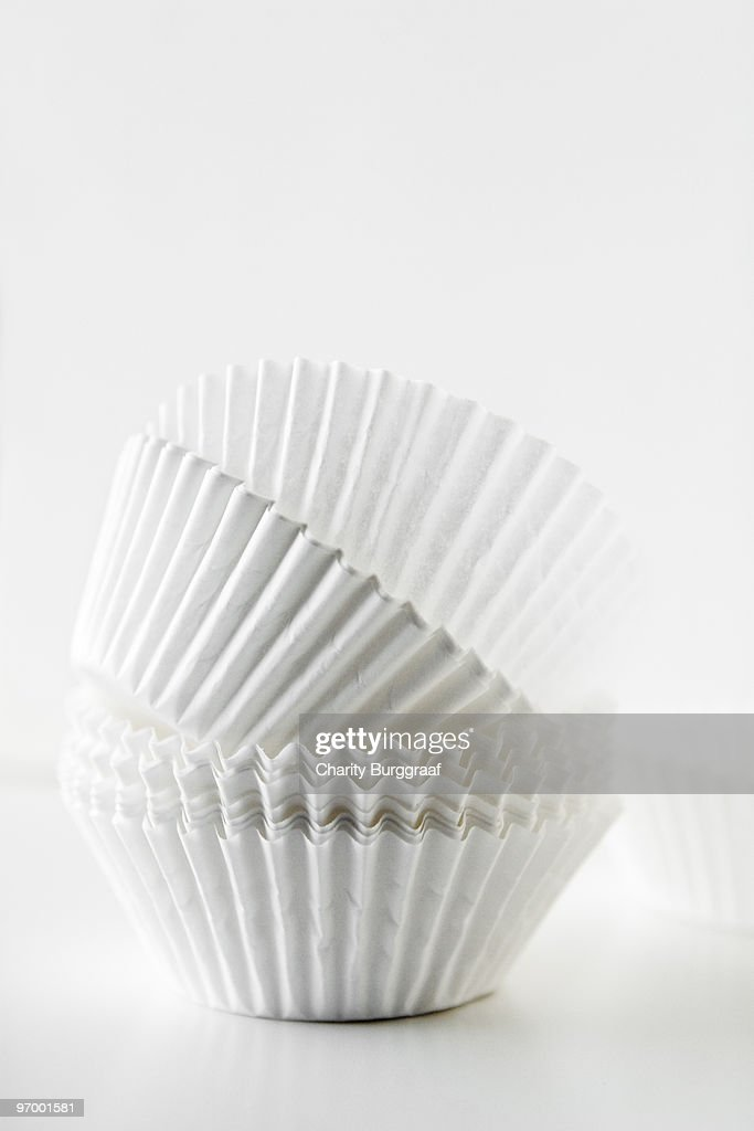 Stack of white baking cups : Stock Photo