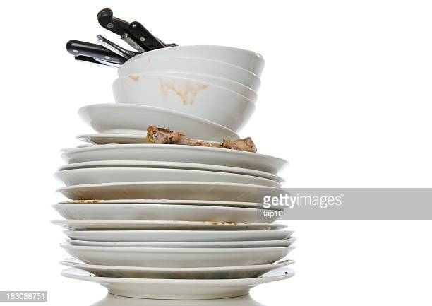 Stack of white dirty dishes on a white background