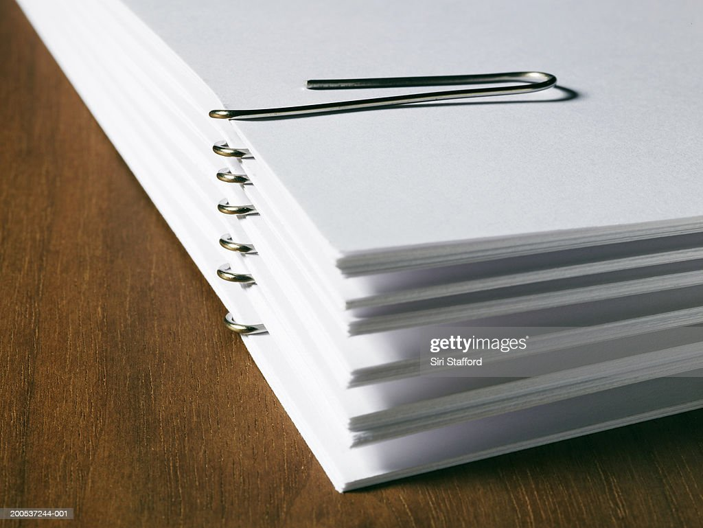 Stack of white papers with paper clips : Stock Photo