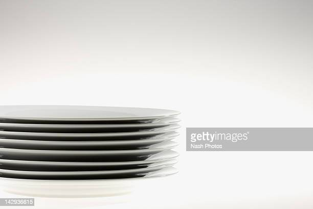 Stack of white plates on white background