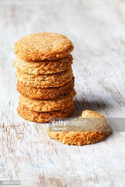 Stack of whole grain cocos cookies on wood