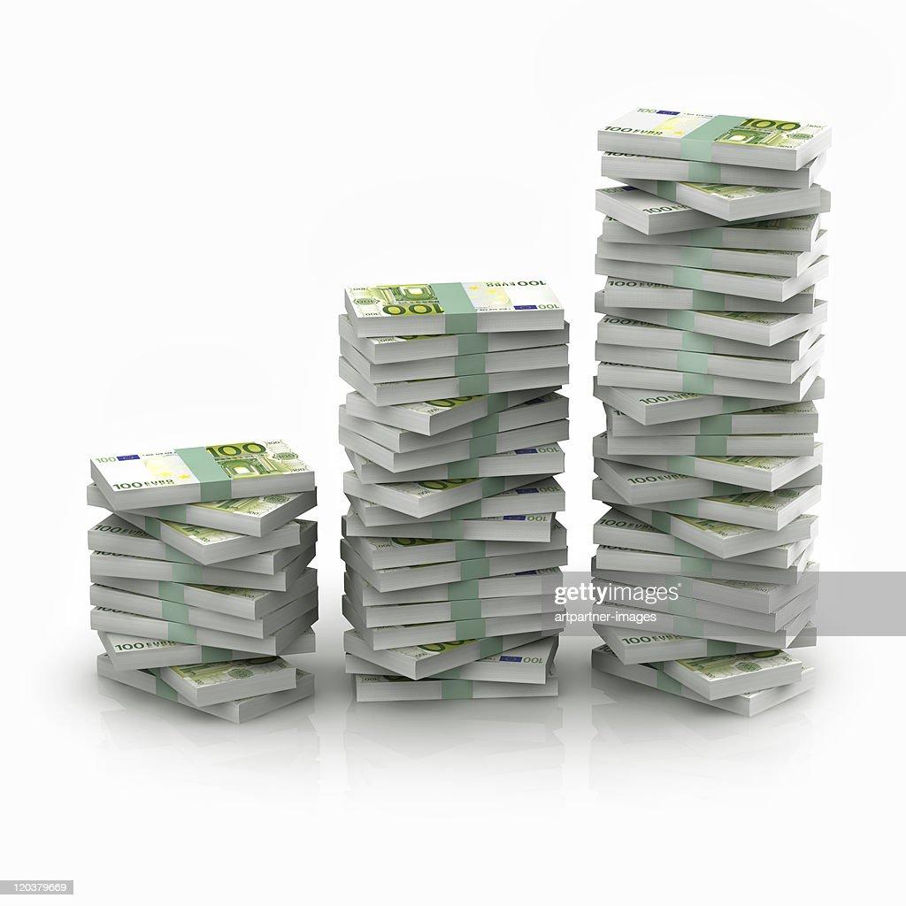Stacked 100 euro bundles on white