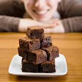 Stacked brownies and smiling woman