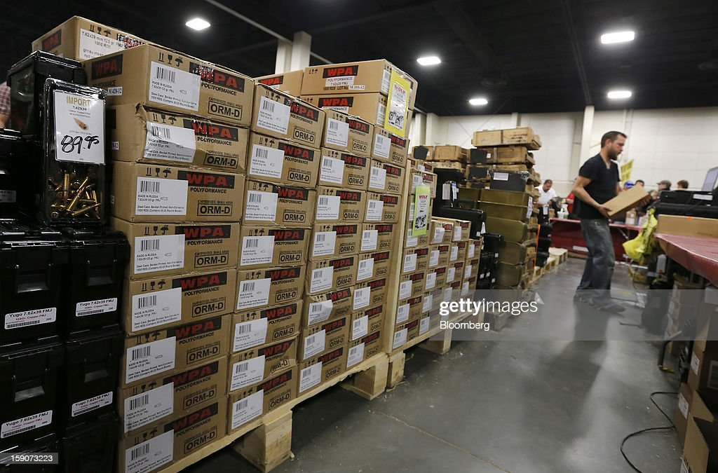 Stacked cases of WPA Polyformance ammunition labeled 'Made in Russia' are displayed for sale at the Rocky Mountain Gun Show in Sandy, Utah, U.S., on Saturday, Jan. 5, 2013. A working group led by Vice President Joe Biden is seriously considering measures that would require universal background checks for firearm buyers, track the movement and sale of weapons through a national database, strengthen mental health checks and stiffen penalties for carrying guns near schools or giving them to minors. Photographer: George Frey/Bloomberg via Getty Images