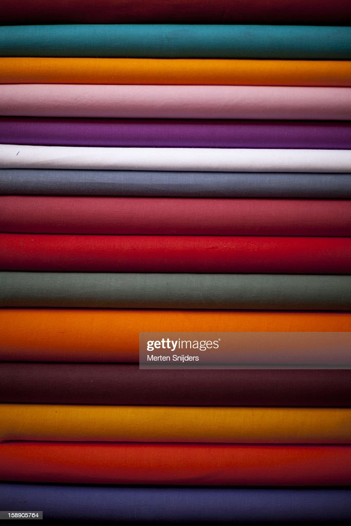 Stacked colorful textiles