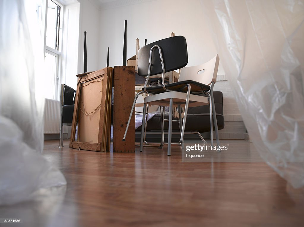 stacked furniture in a room : Stock Photo