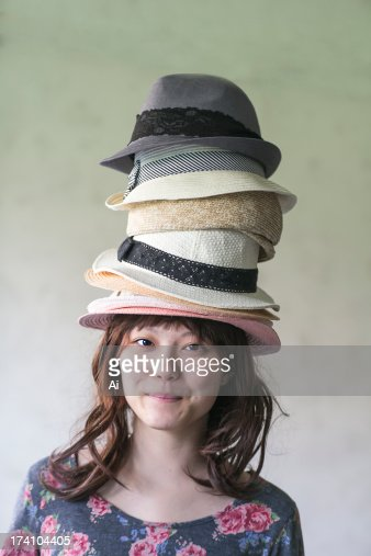 Stacked hat and girl