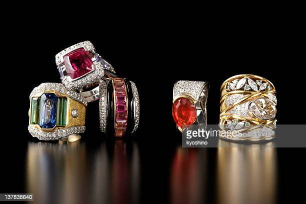 Stacked luxury ring on black background with copy space
