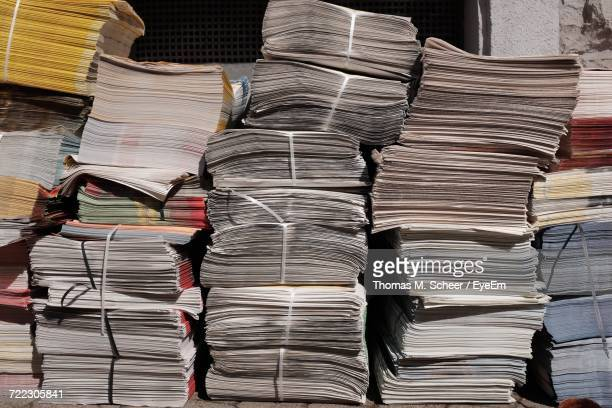 Stacked Newspapers On Sunny Day