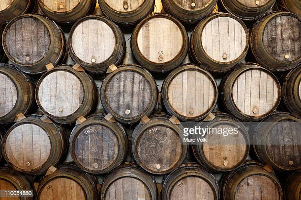 Stacked oak barrels in a winery