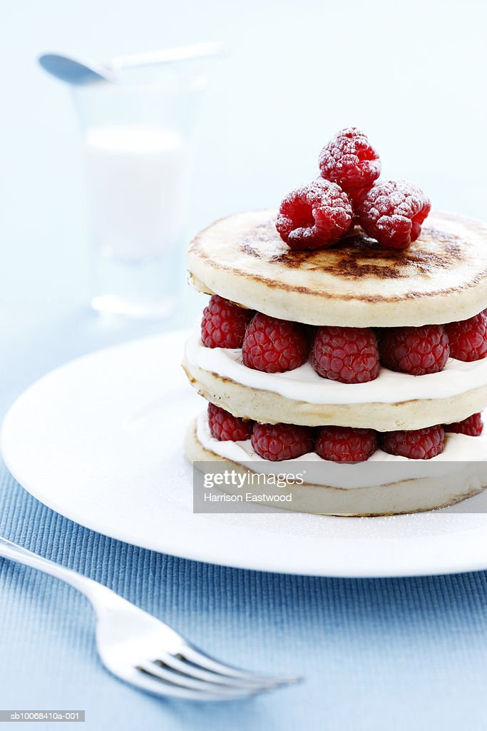 Stacked scotch pancakes with raspberries and clotted cream : Stock Photo