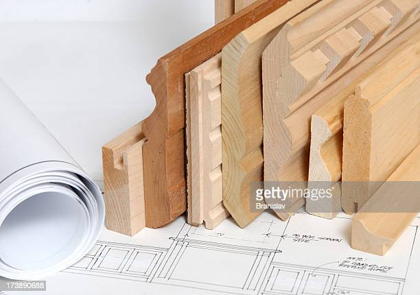 Stacked shelving and molding with blueprints