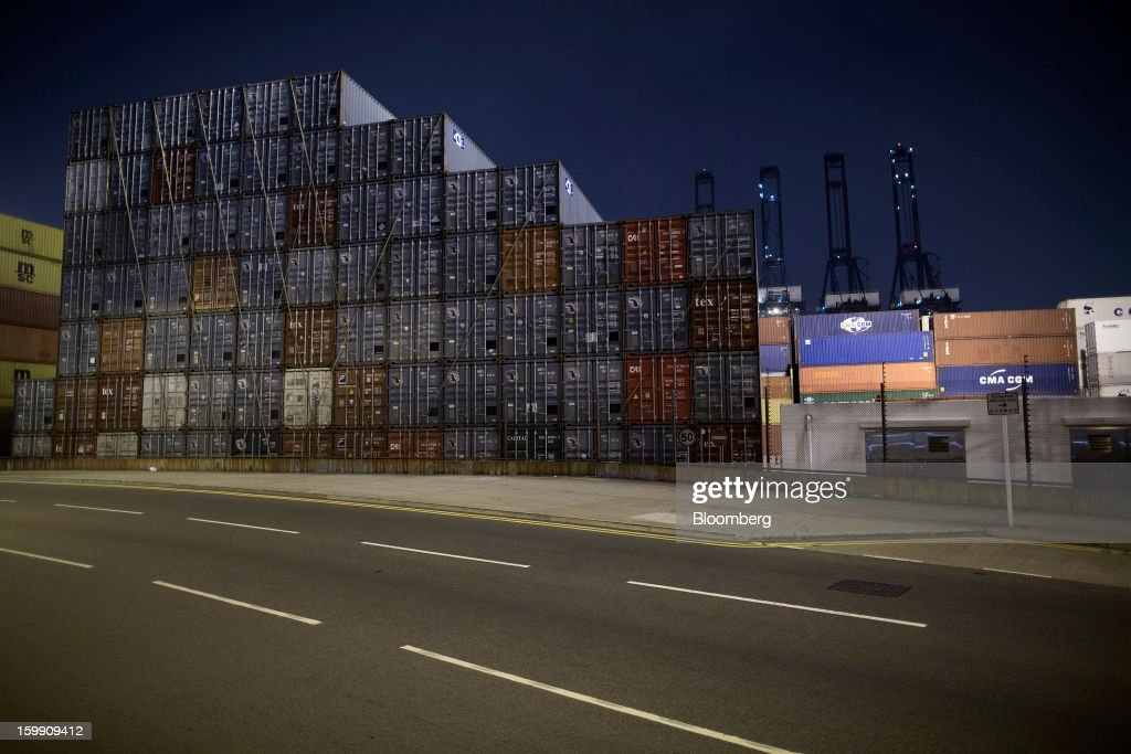 Stacked shipping containers stand at night in the Kwai Tsing Container Terminals in Hong Kong, China, on Tuesday, Jan. 22, 2013. Hong Kong is scheduled to release export figures for December on Jan. 24. Photographer: Jerome Favre/Bloomberg via Getty Images
