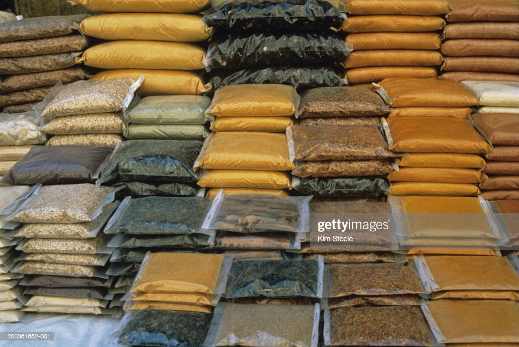 Stacked spice packets at Nile River market : Stock Photo