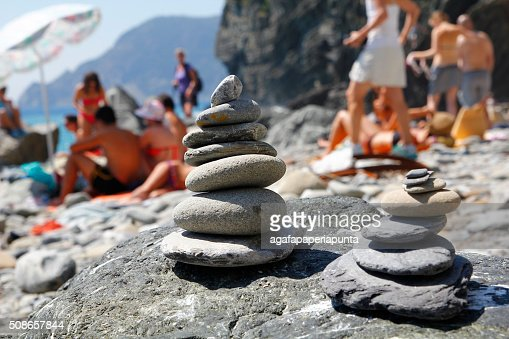 Stacked stones in the beach : Stock Photo