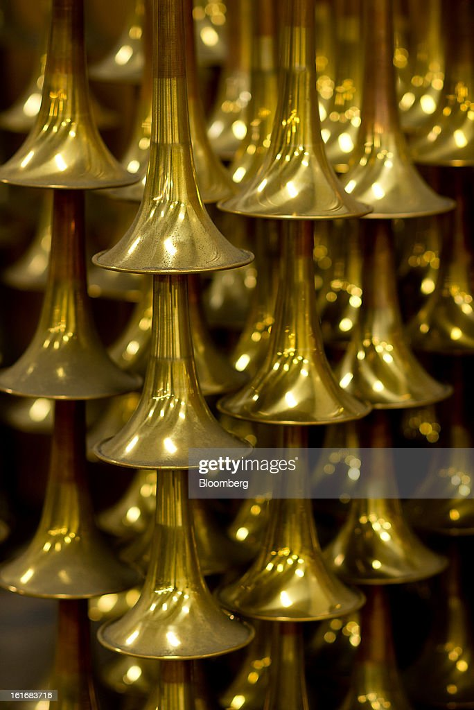 Stacked trumpet bells wait to be buffed and polished in the manufacturing department of the E.K Blessing Co. in Elkhart, Indiana, U.S., on Thursday, Feb. 7, 2013. The U.S. Federal Reserve is schedule to release industrial productions figures on Feb. 15. Photographer: Ty Wright/Bloomberg via Getty Images