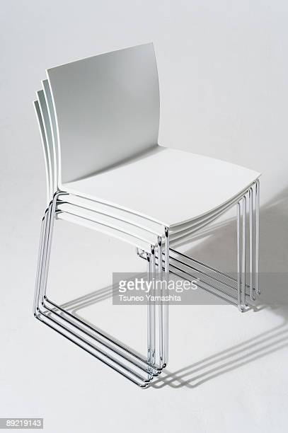 stacked white chairs