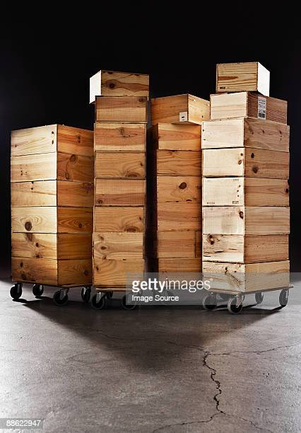 Stacked wooden crates on castors