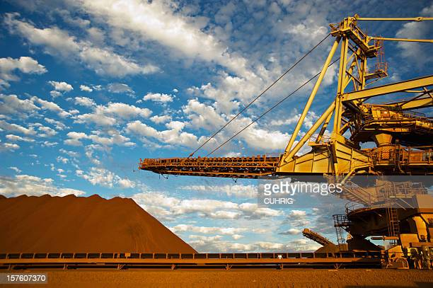 A stacker and stockpile on an iron ore mining site