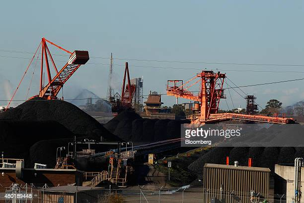 Stackers and reclaimers operate next to stockpiles of coal at the Newcastle Coal Terminal in Newcastle north of Sydney Australia on Monday June 29...