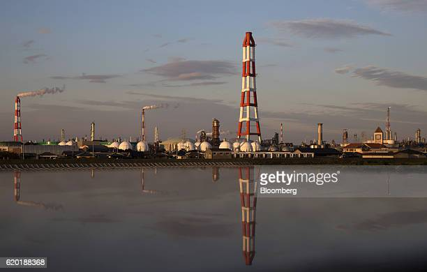 Stacks are reflected in a puddle at the Yokkaichi industrial complex at dusk in Yokkaichi Mie Prefecture Japan on Saturday Oct 29 2016 The Paris...